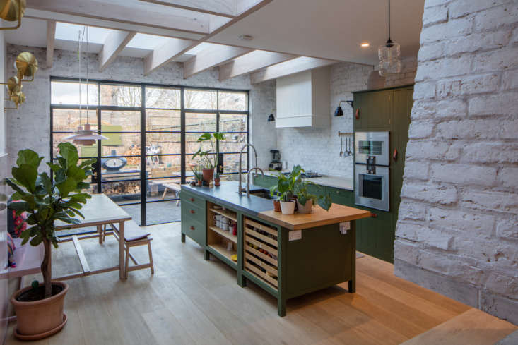 Steal This Look A Polychromatic Dream Kitchen in Hackney London The kitchen cabinets and island are from Plain English&#8\2\17;s Osea kitchen, done up in a custom shade of olive green (see source below). Photograph byLuke Hayesfrom Kitchen of the Week: A Greatest Hits Kitchen for a Danish American Couple in London.
