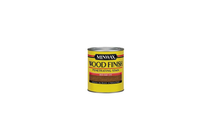 Carla and Niall stripped the cedar wall paneling of white paint and finished it with Minwax Red Oak Interior Stain; $7.96 for a quart via Amazon.