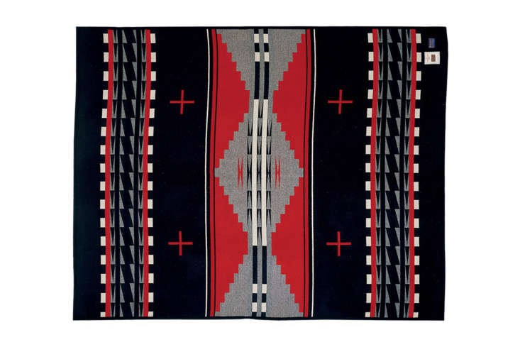 ThePendleton Earth Blanket in black multi is similar to the Pendleton blanket on the bed; $3 at Pendleton.