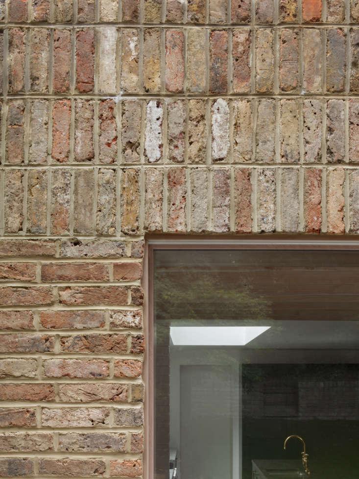 A Kismet Renovation in Highbury London by OSullivan Skoufoglou Architects A look at where the sapele wood sliding door frame meets the brick façade.