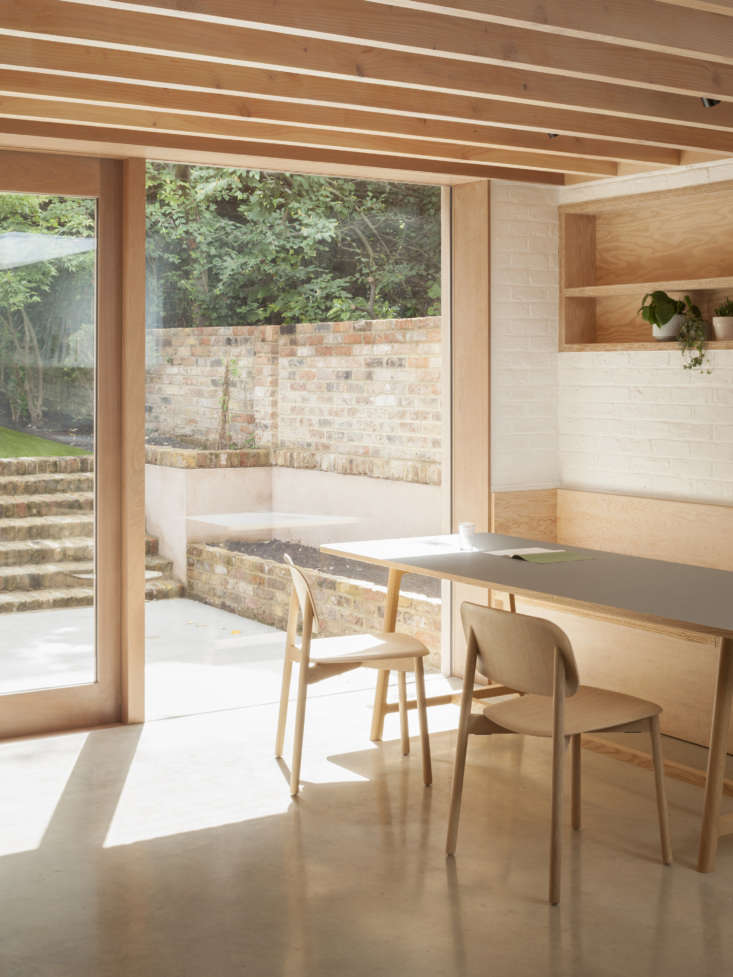 A Kismet Renovation in Highbury London by OSullivan Skoufoglou Architects The dining table is theFrame Table with a gray linoleum top by Hay and the chairs, also Hay, are Soft Edge \1\2 Chairs in oak.