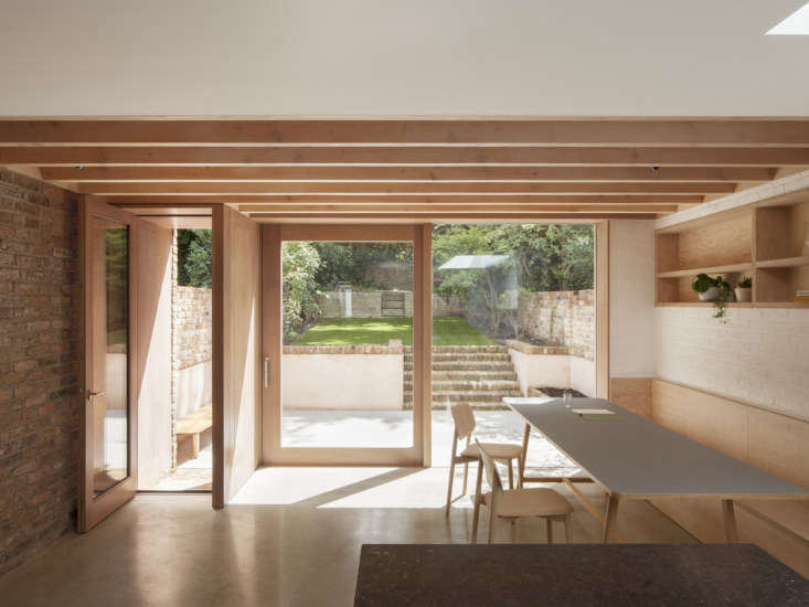 A Kismet Renovation in Highbury London by OSullivan Skoufoglou Architects To start, the architects removed the unnecessary internal walls and extended the building \1.5 meters (about five feet) from the rear façade to create space for a dining area. The window and sliding door frame is made from sapele, a mahogany wood native to Africa. The floors are \150mm thick (about six inches) polished concrete in Henley BuffbyThe Concrete Flooring Contractors laid over a radiant heating system. The ceiling lights are Black Tube Spotlights from Mr. Resistor.