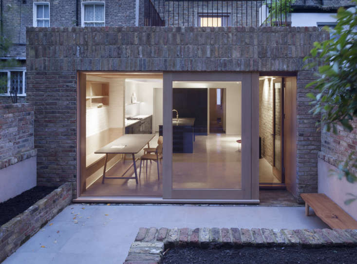 A Kismet Renovation in Highbury London by OSullivan Skoufoglou Architects The rear wall is designed with both a sliding door and recessed single glass door that offers an alternative entry to the garden.