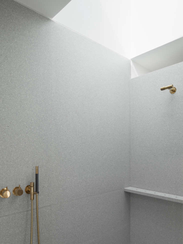 A Kismet Renovation in Highbury London by OSullivan Skoufoglou Architects The shower is clad in Terrazzo Cement and outfitted with a Vola Thermostatic Mixer (547\1R 08\1) in natural brass.