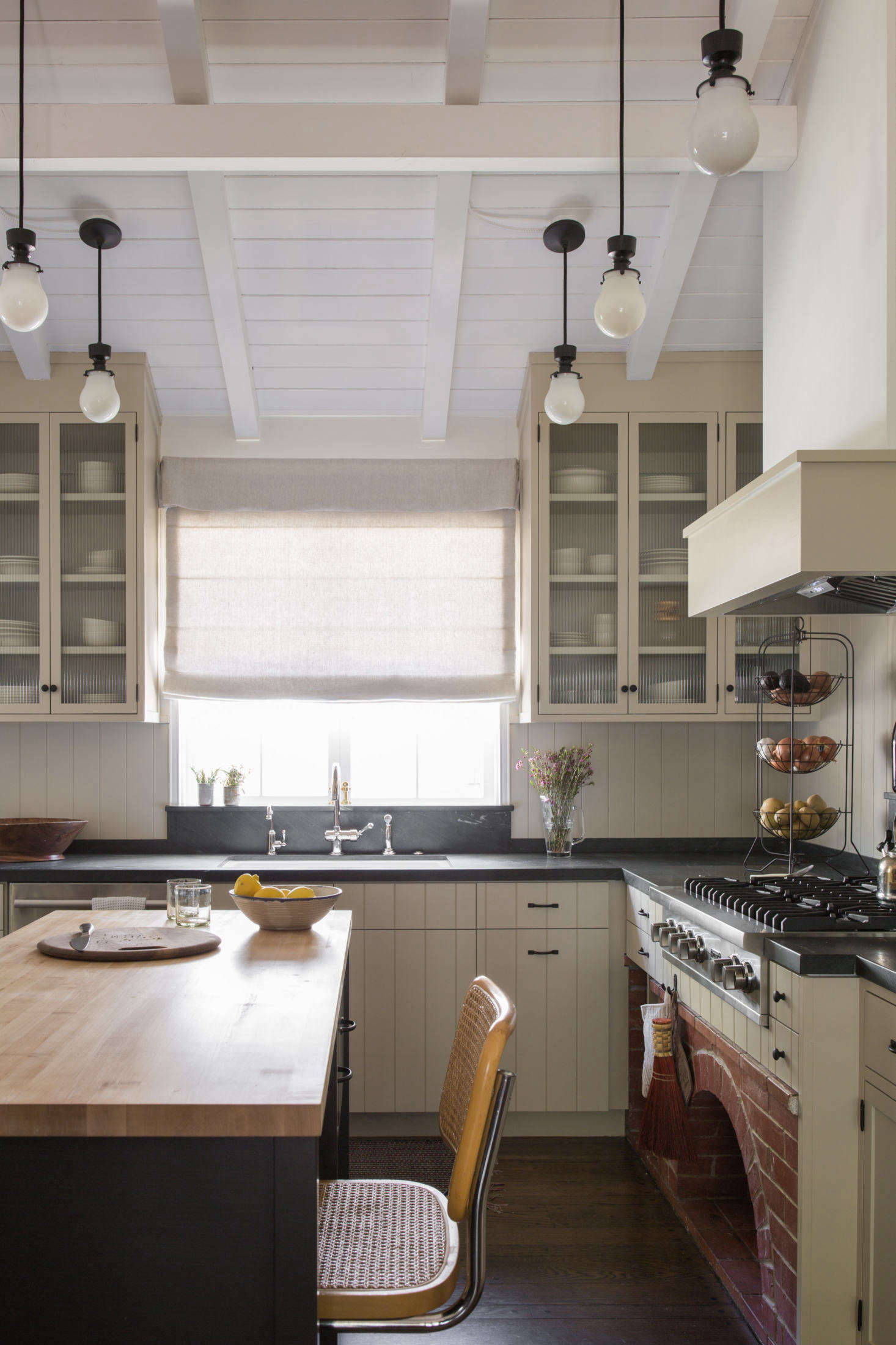 The finished kitchen is open and bright, thanks to some structural changes: &#8
