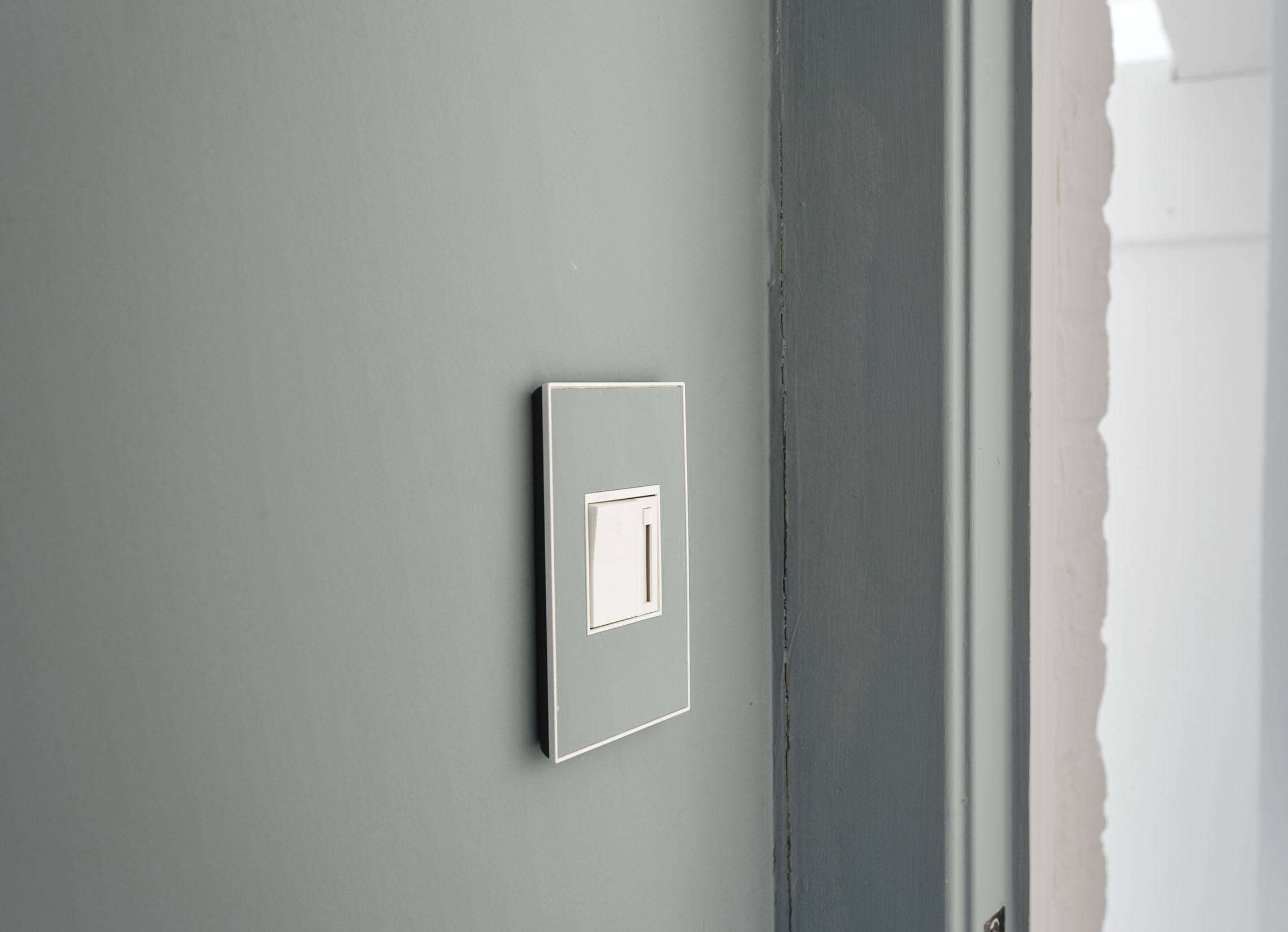 Legrand Adorne Wall Plates are available in custom colors. For more information see Legrand. Photograph from  Design Ideas to Steal from an Über Creative Remodel by Studio Oink. Studio Oink Washington D.C. Remodel.
