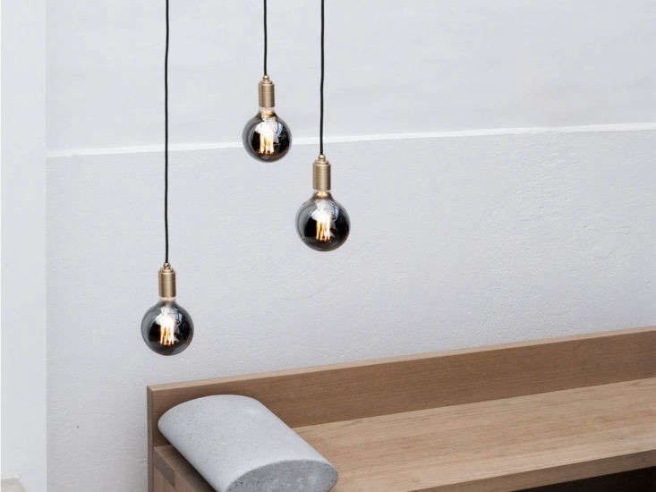 Tala designed a unique filament structure for the Gaia 6 Watt bulb—its modern take on a traditional, blown-glass, exposed-filament sphere. Available tinted (shown) and clear, it&#8