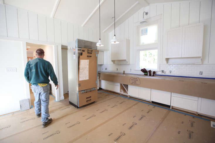 Appliance install in a kitchen with FloorShell protection on floors andX-Paper on the soapstone countertops. X-Paper is loading=