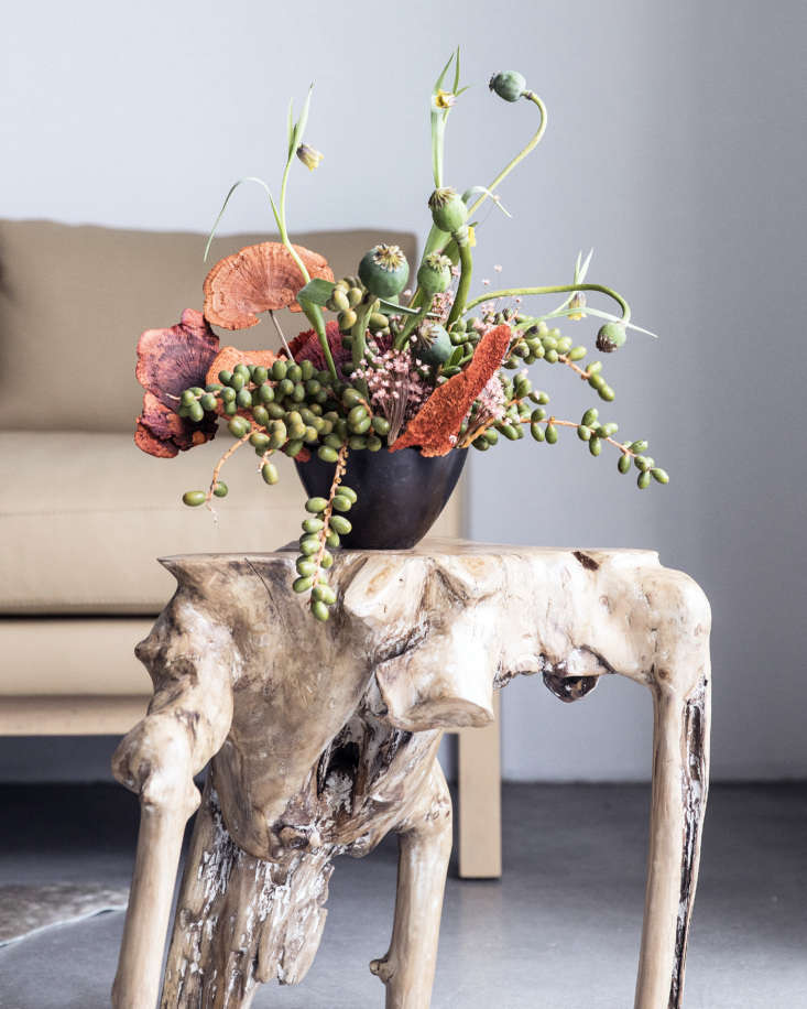 Shoppers Diary New Furniture Designs from Home Enthusiasts TRNK A floral arrangement byFelisa Funes of Of the Flowers in Los Angeles sits on a burl wood side table.