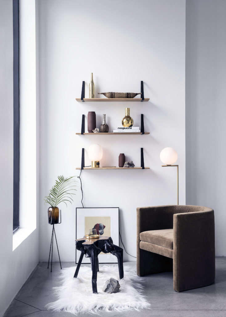 Shoppers Diary New Furniture Designs from Home Enthusiasts TRNK The Arc Chair, similar in scale to the Angle Chair design above but with a curved shape, is shown in twine velvet.The shelves are black Powder Coated Metal & Oak Shelves and the light is theIC Floor Lamp byMichael Anastassiades.
