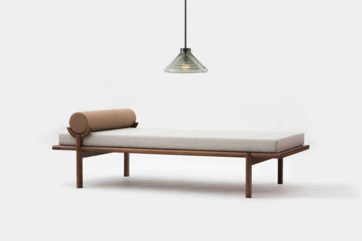 the crescent lounge, shown in an ochre and gray wool combination and walnut fra 10