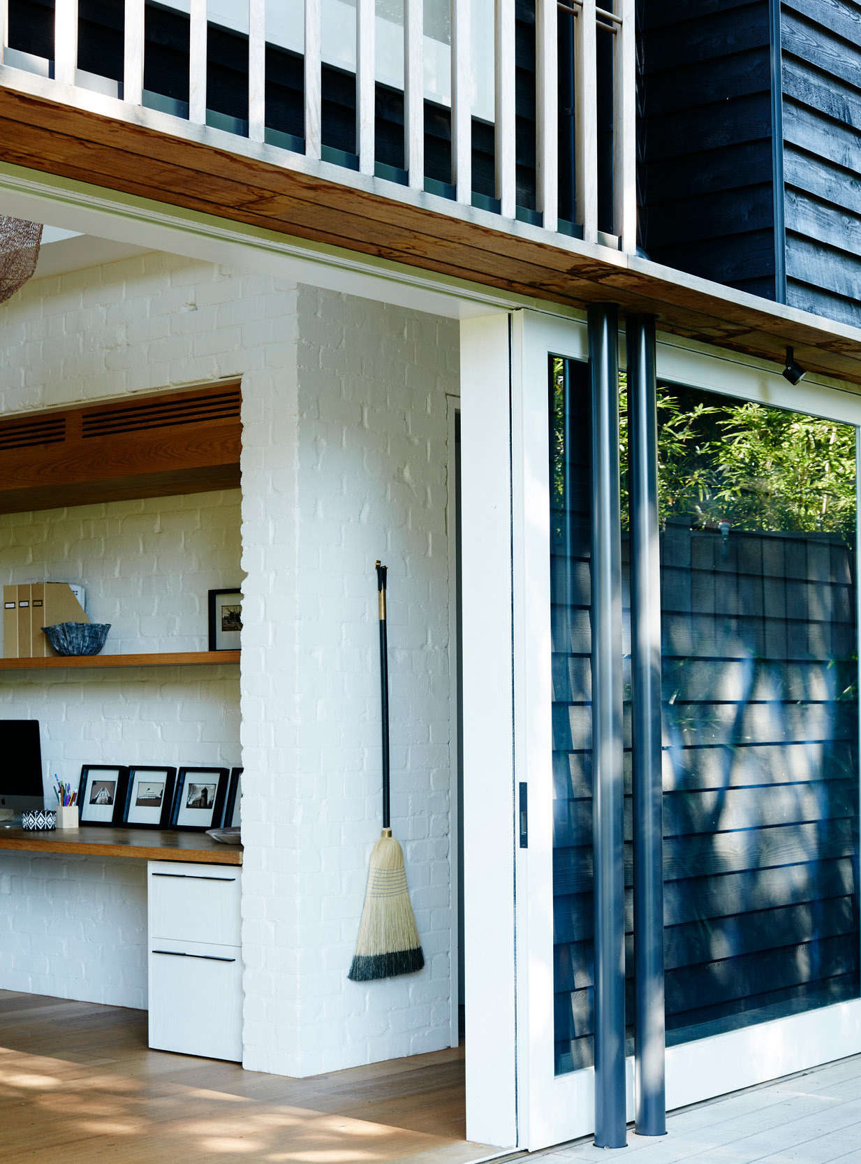 Also in Australia, an architect displays a black-accented broom that complements his home&#8