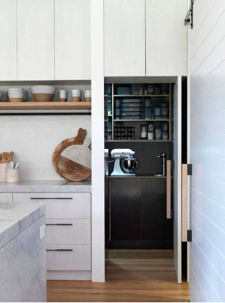 Cabinets in the walk-in pantry received the same treatment as the main kitchen cabinets, but in black. The floors throughout the main level areengineered European oakboards.