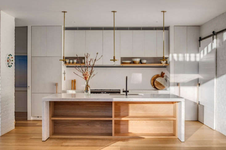 The kitchen cabinets are American oak veneer with a matte white, hand-painted finish. &#8