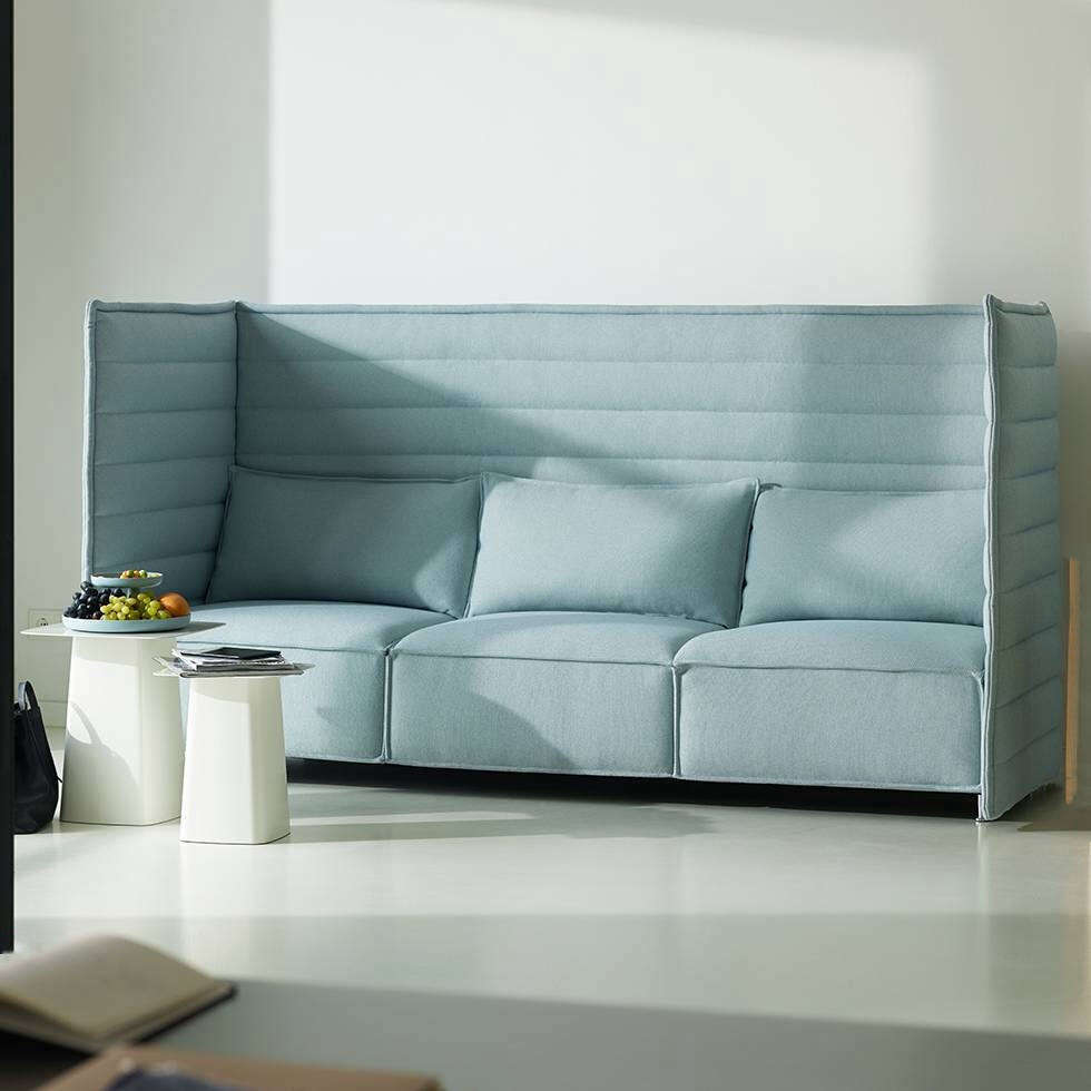 The Vitra Alcove Plume Three-Seater Sofa is a Ronan and Erwan Bouroullec creation with high, flexible sides and back panel and thick seat cushions that, according to Vitra, &#8