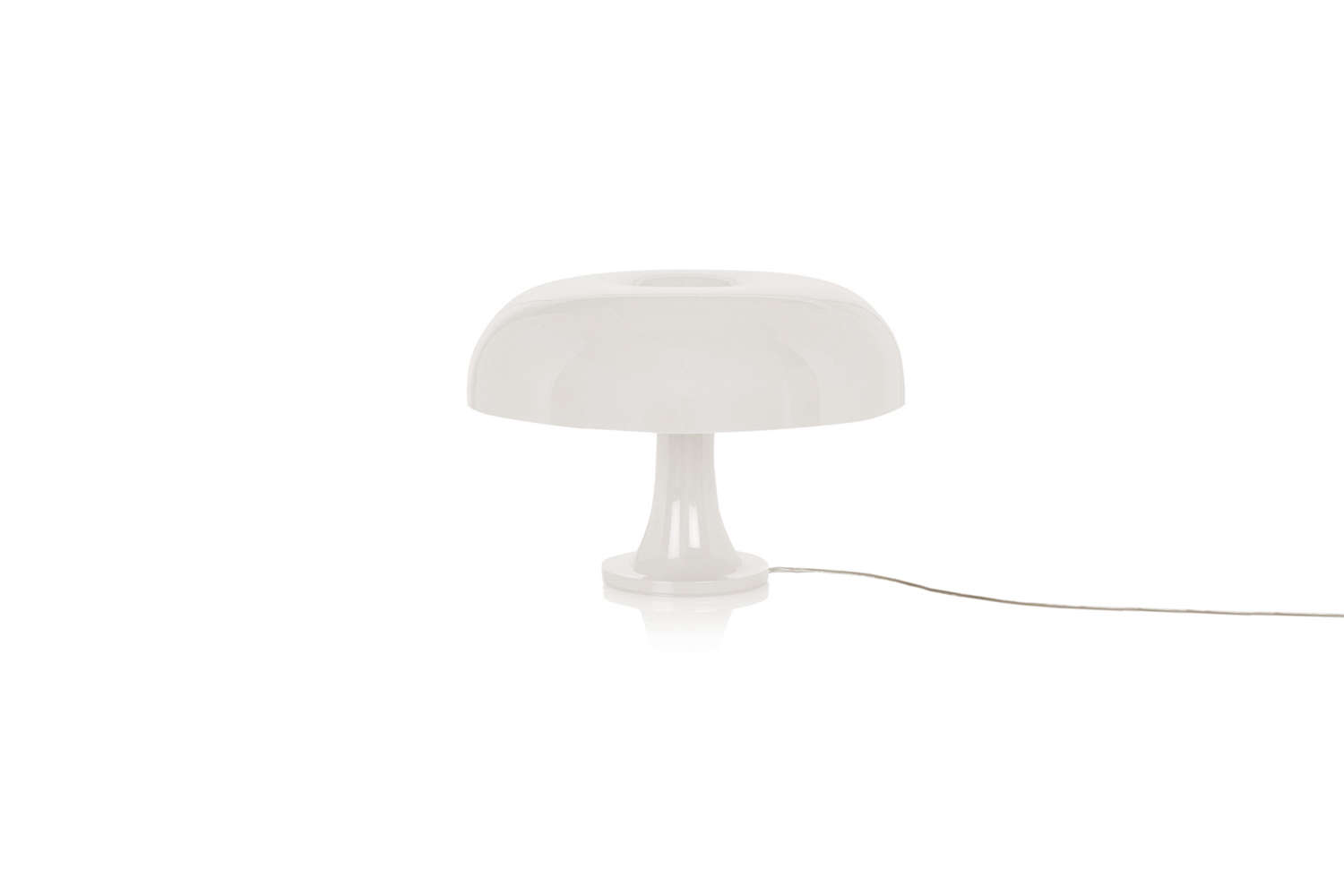 On the built-in desk is the Artemide Nesso Table in white; $430 at Lumens.