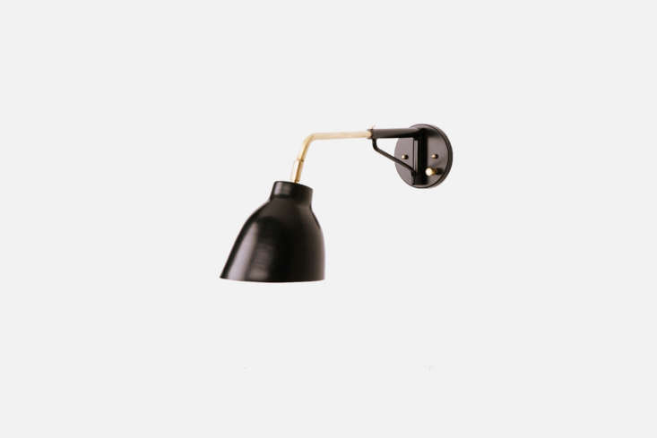 Steal This Look A Polychromatic Dream Kitchen in Hackney London Flanking the ventilation hood above the kitchen counter are two Navire Jib Sconce lights in powder coated black from Atelier de Troupe; \$650 each.
