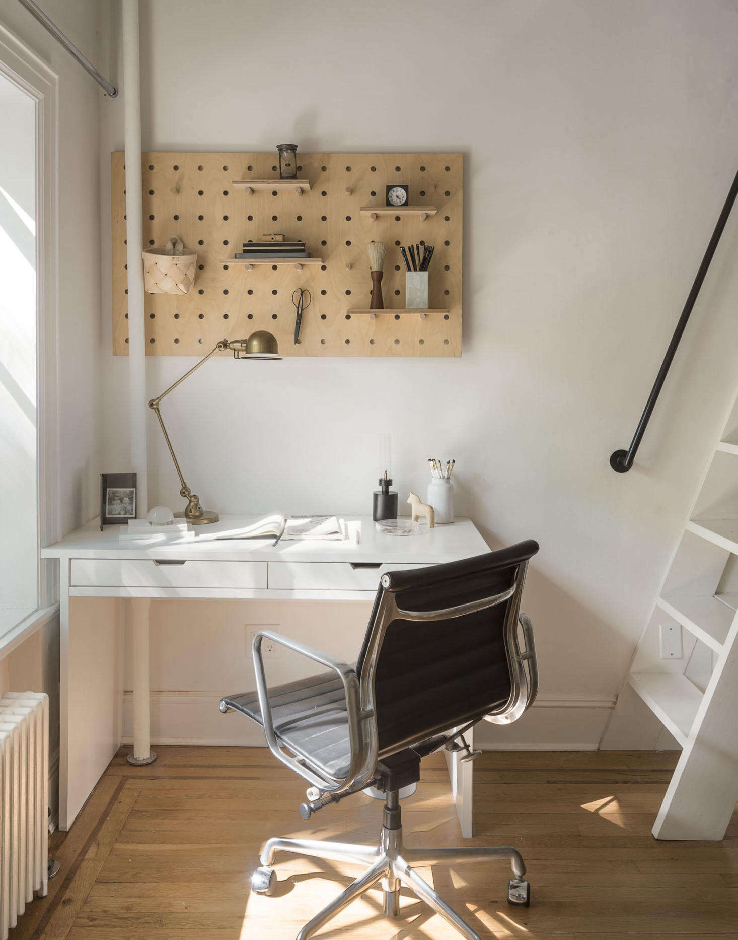 A birch wood pegboard from Kreisdesign allows for flexible storage in Julie and Josh&#8