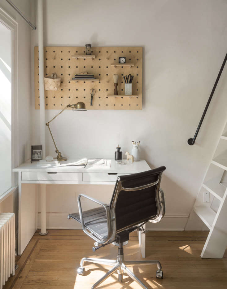 Malachi designed a small desk to fit discretely in a corner, illuminated by a bronze Jielde Signal Desk Lamp  from Horne. The birch plywood peg board is from Kreisdesign. (See Remodelista contributing editor Justine Hand&#8