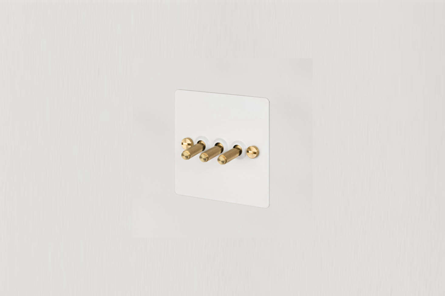 Lights throughout the kitchen operate by way of Buster & Punch 3G Toggle Switches in White and Brass; £74 each.