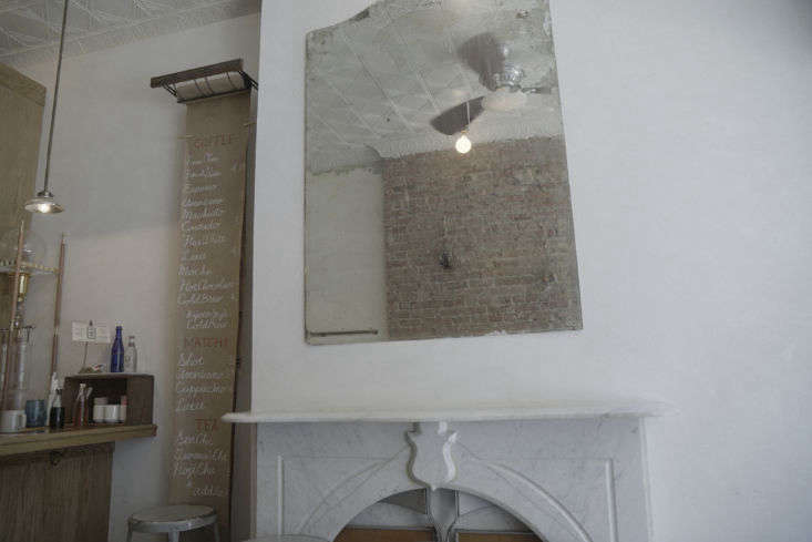 On one side of the small room, the team preserved an existing marble mantel, presumably from a long-ago time when the building was a residence. Behind it, the day&#8