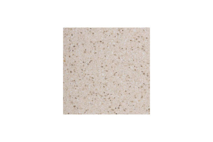 The countertops are made from local terrazzo. For something similar, the Eco Cosentino Luna Quartz Kitchen Countertop is available from Lowes.