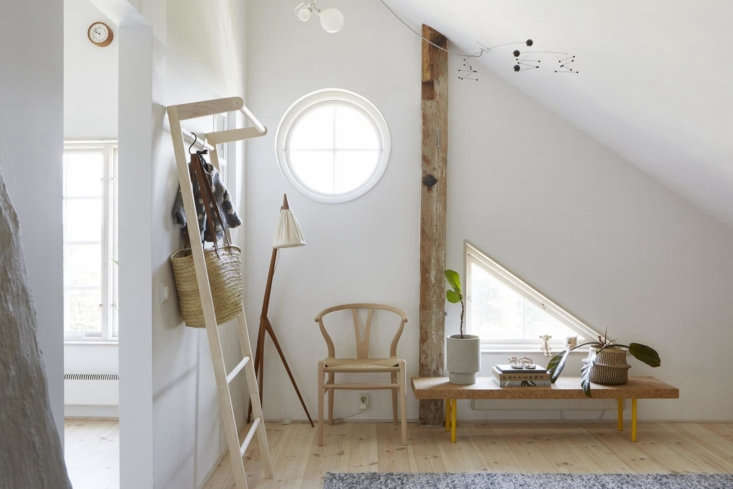 The master bedroom is outfitted with Scandinavian furnishings, including a Wishbone Chair by Hans Wegner.