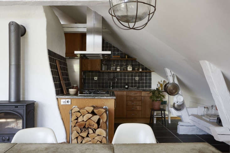 The kitchen is tucked around the corner from the dining room. It has oak cabinets from Swedish brandBallingslöv, plus granite countertops and a Bosch dishwasher, oven, stove, and microwave.