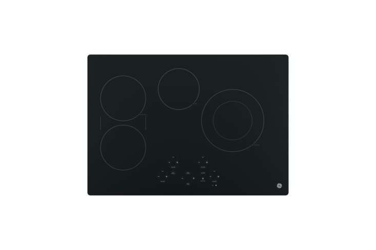 Most of the kitchen appliances are integrated behind cabinet panels. The GE 30-Inch Profile Smooth Surface Electric Cooktopis similar to the cooktop Caroline and Steffan chose. It&#8