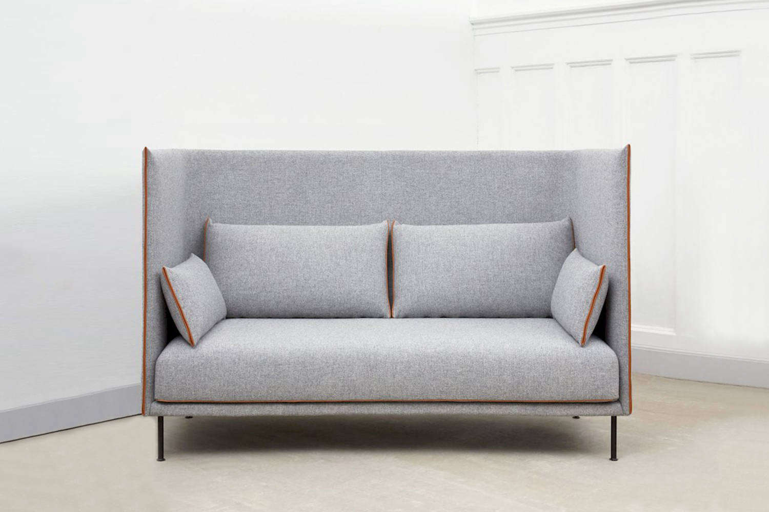 The HAY Silhouette High Backed Sofa is made with a fiberglass shell and oak frame and is covered in Kvadrat fabric with leather piping. Available as a