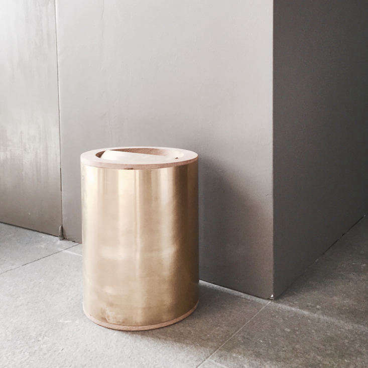 The Flip waste bin is made of brushed brass with a lid of oiled oak.