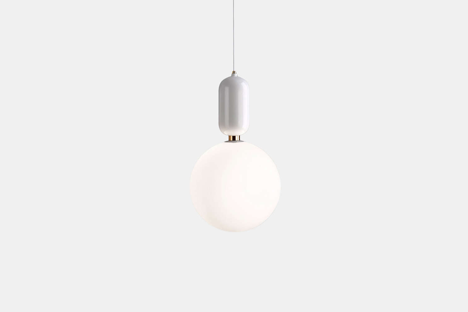The pendant light is the small whiteAballs Pendant Lamp by Jaime Hayon and Parachilna. Contact A + R Store for pricing and ordering information.