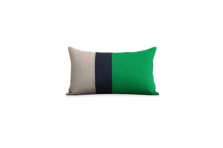 The small color-blocked throw pillow on the bed is from Brooklyn-based French designer Corinne Gilbert. For something similar, the handcrafted Jillian Rene Decor Colorblock Pillow in Kelly Navy and Natural is $75 at the designer&#8