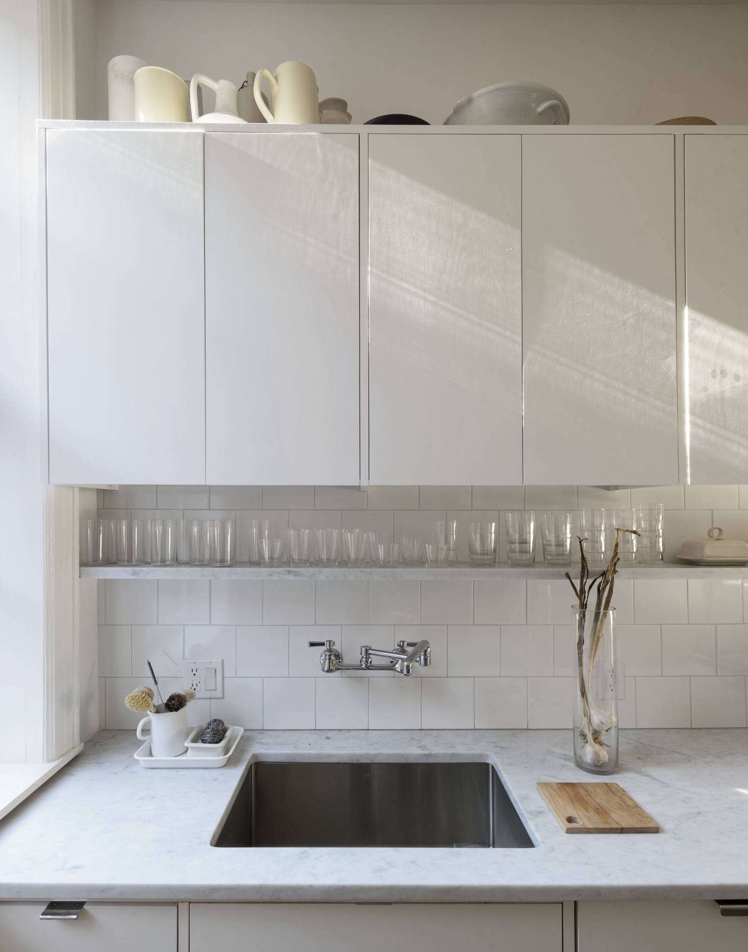 We turned to Brooklyn-based Jeremy Pickett of Pickett Furniture (one of our earliest Remodelista advertisers, back in the late aughts) for the minimally detailed cabinets. The countertops are Carrara marble. (For countertop guidance, see our post Remodeling src=