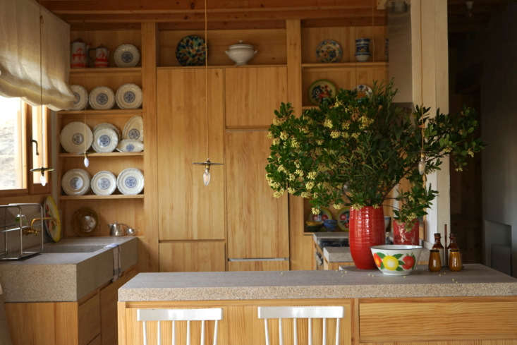 the pine continues into the kitchen where it&#8\2\17;s modernized with coun 15