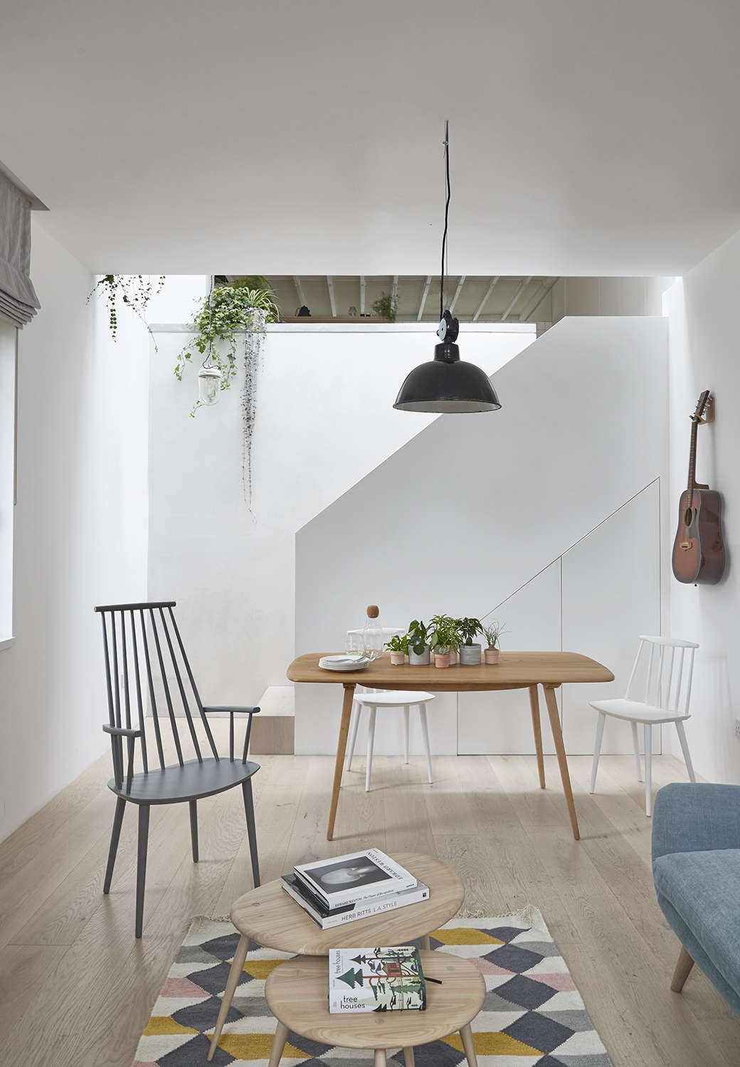 Among the biggest changes to the space: moving the stairway into the center of the house, near the kitchen. Hutchinson also installed a wide skylight over the stair to bring a shaft of light into the darker back areas. Underneath the stair, the hot water heater and extra storage—&#8