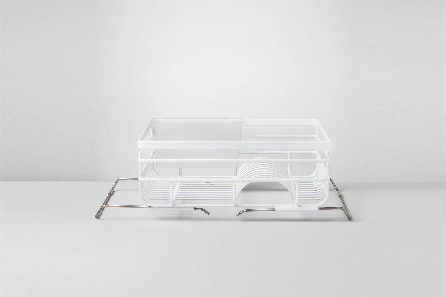 The Made by Design Over-the-Sink Wire Dish Rack adjusts to different sink sizes and can be fitted across or lengthwise over the sink; $loading=