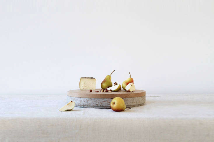 The Chop wood chopping board, made of either oiled teak or beech, sits atop theCircle serving tray made of marble or terrazzo.