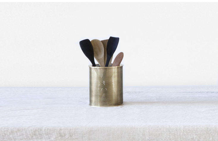 Available in two sizes,Filter is a perforated, brushed brass pot perfect for storing utensils.