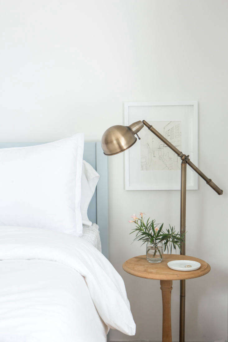 In the guest bedroom, the simple bed frame is painted inBenjamin Moore'sWoodlawn Blue.
