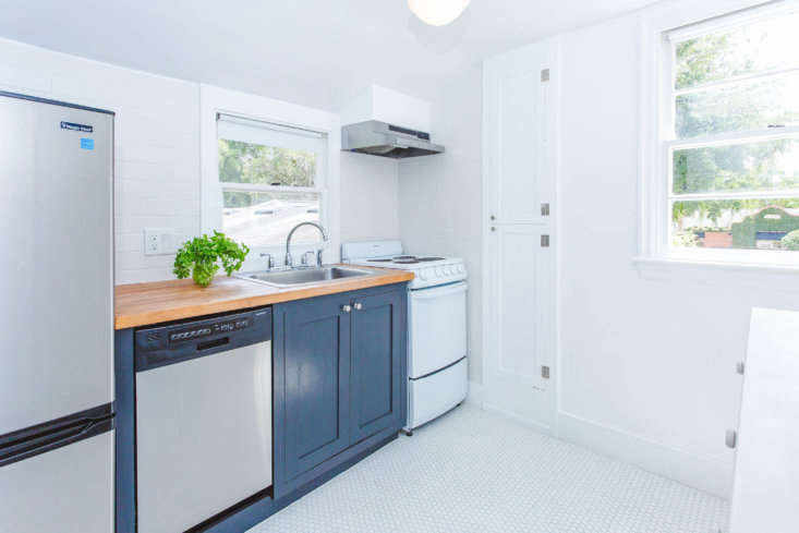 The house also came with a small apartment above the garage, now outfitted simply, with the same hexagonal tile used in the main-house bathroom and cabinets painted in Benjamin Moore&#8