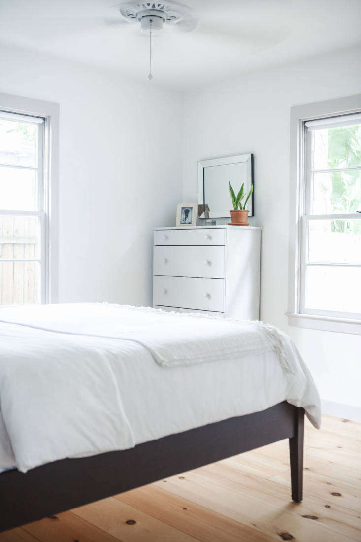 The dresser at the foot of the bed is the Tarva from Ikea, painted (again, by Maslow) in Benjamin Moore&#8