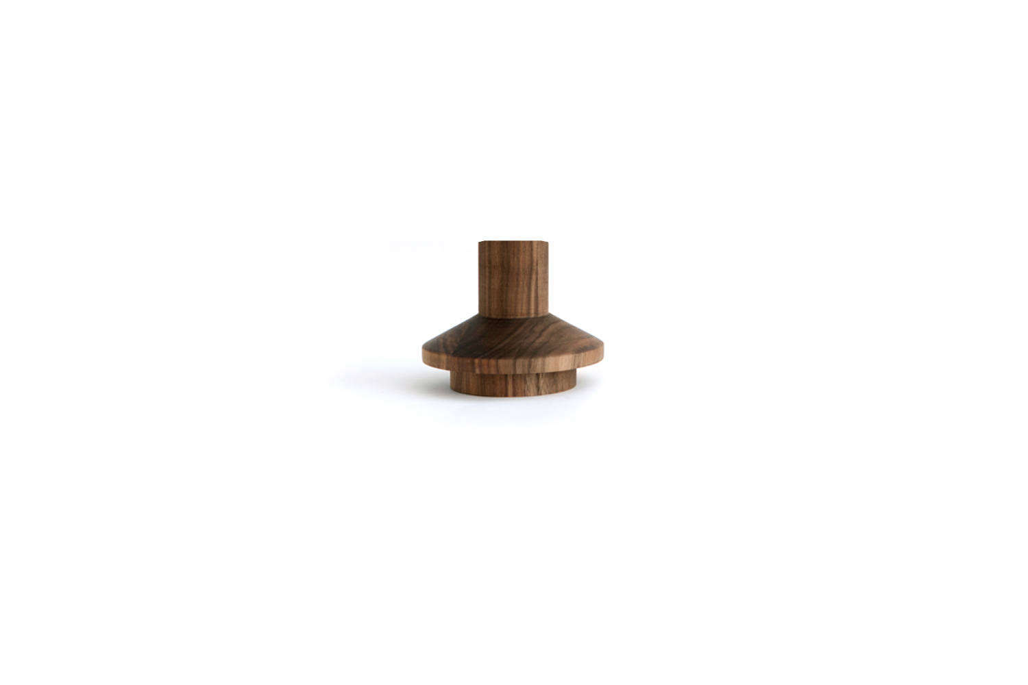 The Michaël VerheydenLighthouse Candle Holder in walnut is available in the -inch tall size for $9 at Luminaire.