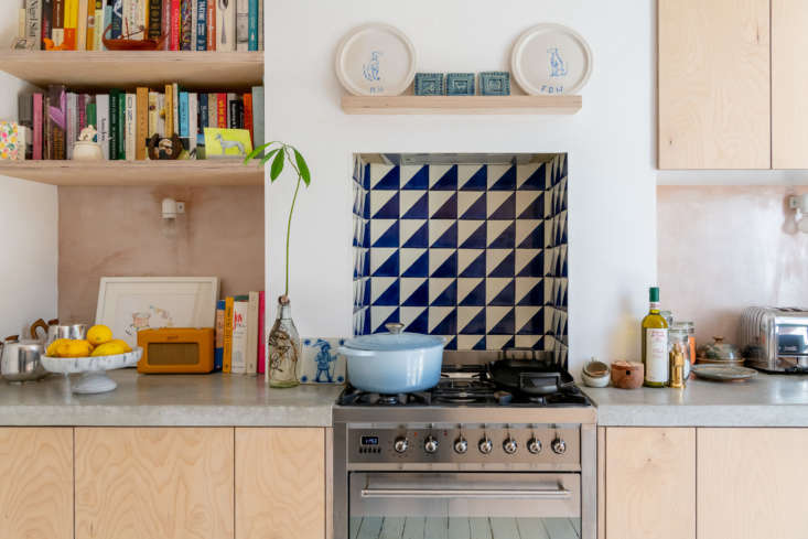 The plywood shelves and cabinets are treated with Osmo Polyx-Oil. The counter is made-to-measure polished concrete—the couple's biggest remodeling splurge—from Designfinger in London. The range is a Smeg Dual Fuel Cooker and the tiles are harlequin encaustic tiles from Milagros in East London.