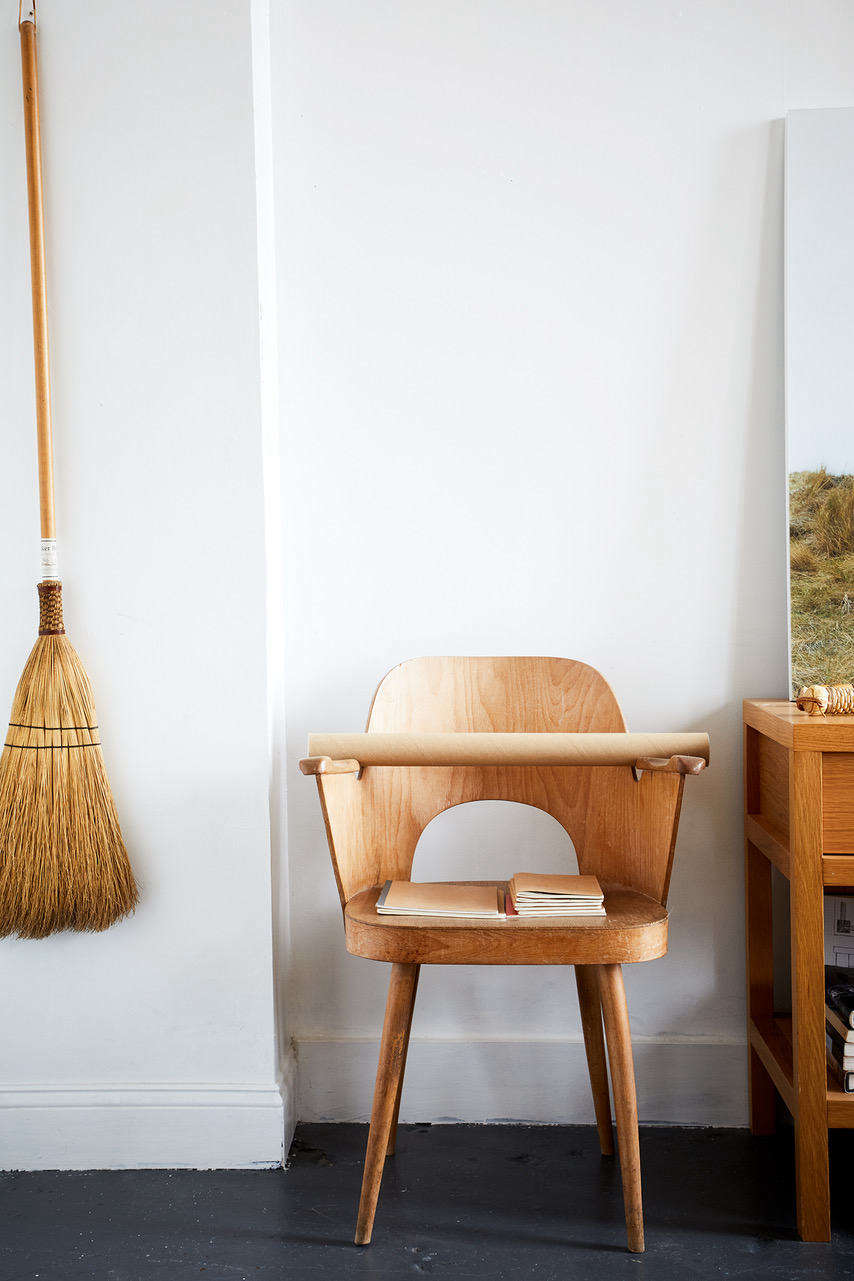 A broom echoes the wood tones of the chair to create a quiet vignette in an open-plan Brooklyn loft (a finalist in our Considered Design Awards). See the full submission here:HomeStories Open Plan Industrial Space.