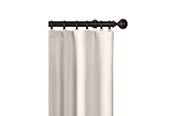 The Belgian Heavyweight Textured Linen Drapery with Rod Pocket in Natural starts at $9 per panel from Restoration Hardware.