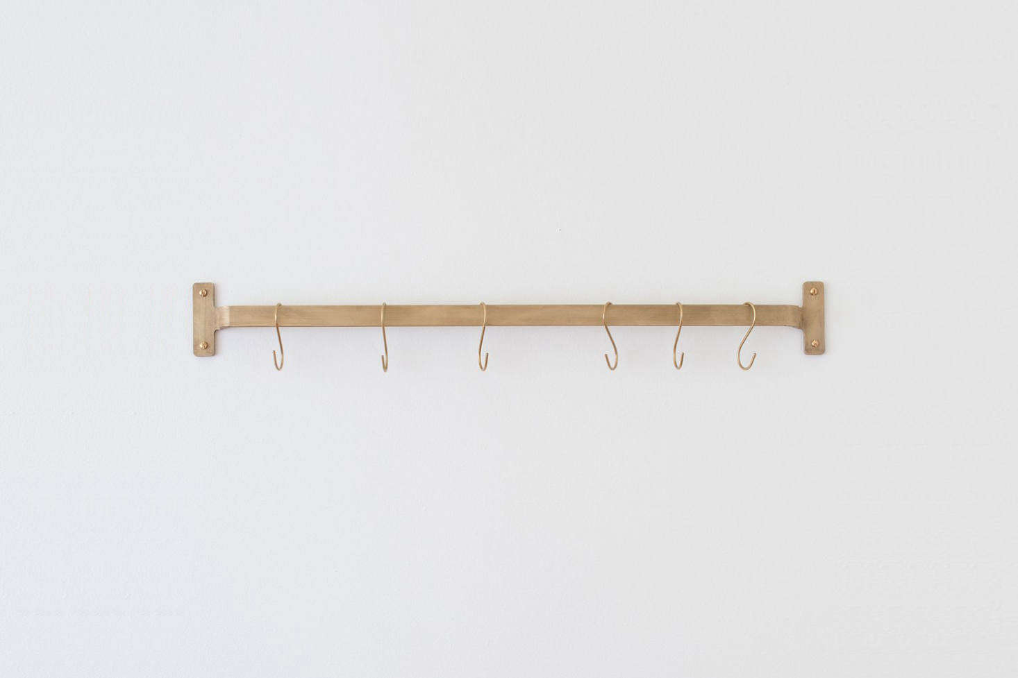 The Nicolai Utility Rail in Natural Brass that hangs on the kitchen wall is $9 at Schoolhouse.