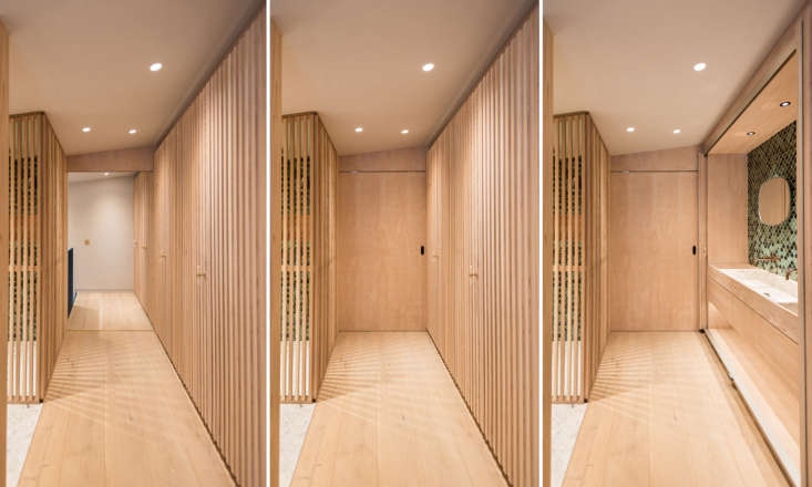 Cedarwood sliding doors and screens define the entrance to the master suite, with bathroom at left and sink on the right, part of a continuous, -foot-long wall of slatted wood joinery. &#8
