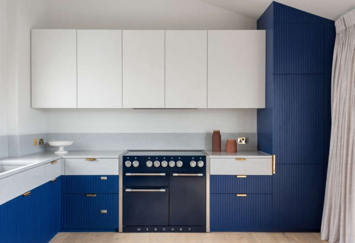 The custom kitchen cabinets have oak interiors and hand-painted wood fronts. &#8
