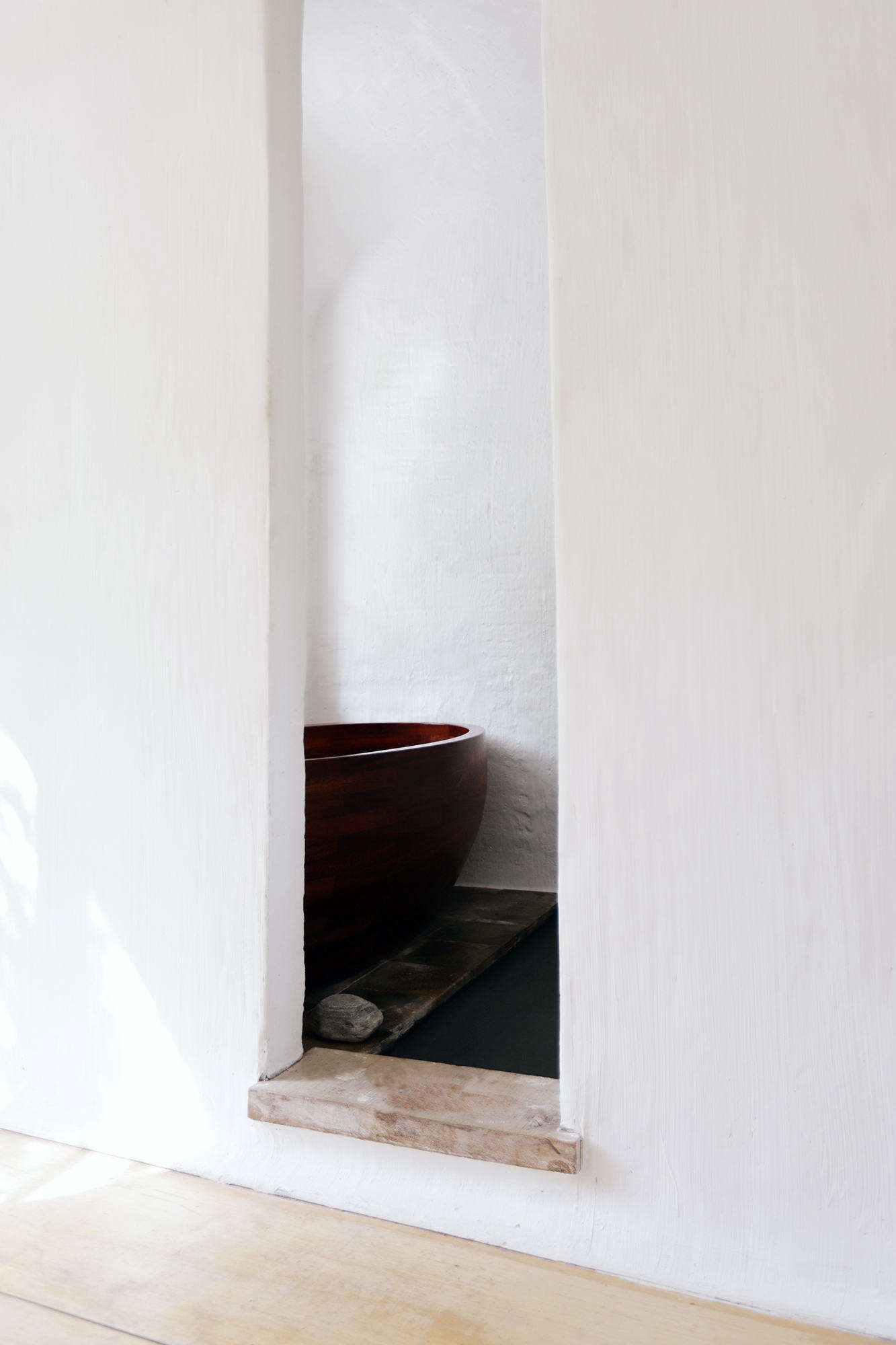 The bathtub was fashioned from rosewood.
